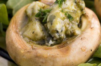 Photo of Harlan Kilstein's Completely Keto Pesto Stuffed Mushrooms