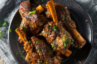Photo of Harlan Kilstein's Completely Keto Braised Juicy Herb Lamb Shanks